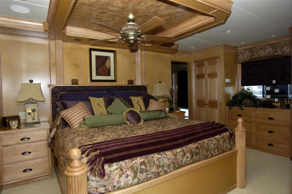 master bedroom with recessed ceiling fan and custom woodwork